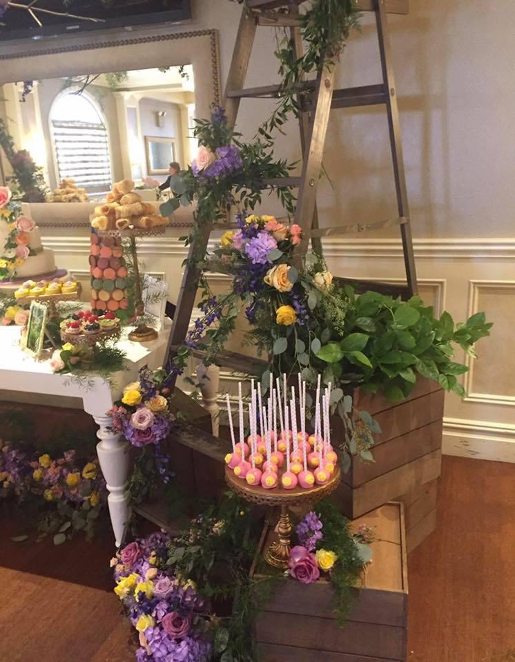 Secret garden entrance dessert table